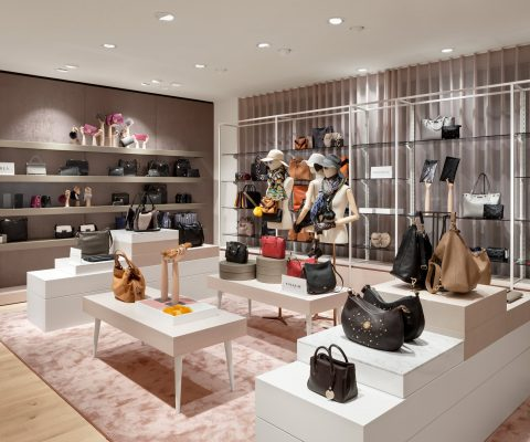 tailor's mannequins and handbags in a modern fashion store