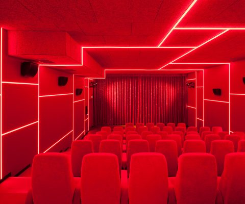 Delphi LUX, theater 3, colors red with red led lights at the ceiling and the walls, Photo by Daniel Horn