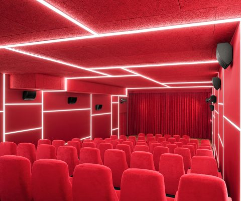 Delphi LUX, theater 3, colors red with white led lights at the ceiling and the walls, Photo by Daniel Horn