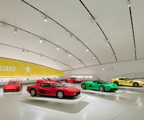 historical and modern ferrari cars in museum